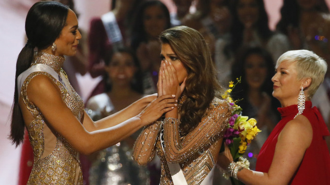 Copyright 2017 The Associated Press. All rights reserved. This material may not be published, broadcast, rewritten or redistributed without permission. Mandatory Credit: Photo by AP/REX/Shutterstock (8137792ap) Iris Mittenaere, Raquel Pelissier Miss France Iris Mittenaere, center, reacts upon becoming the Miss Universe 2016 as Miss Haiti Raquel Pelissier, left, congratulates her, at the Mall of Asia in suburban Pasay city, south of Manila, Philippines. Pelissier was the runner-up Miss Universe Pageant, Pasay, Philippines - 30 Jan 2017